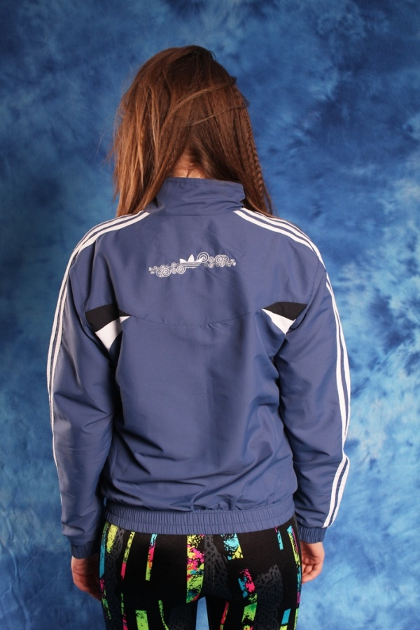Vintage 90s ADIDAS navy jacket with a big logo at the back